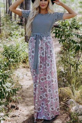 Robe longue rose à imprimé floral avec poches à ceinture
