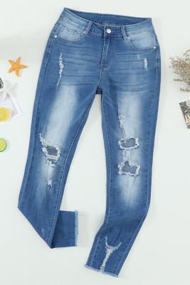 Verblasste mittelhohe Jeans mit Löchern