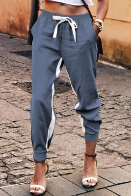 Pantaloni casual blu con coulisse a righe