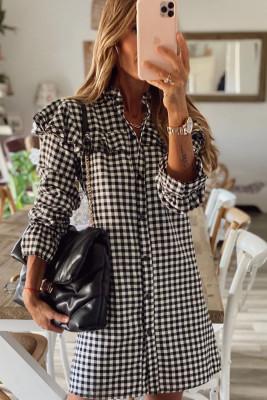 فستان قصير بأكمام طويلة مكشكش أسود منقوش بأزرار
