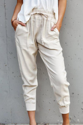 Pantalones bolsillos causales albaricoque
