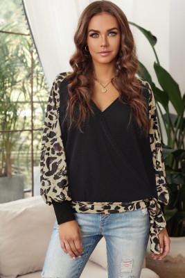 Schwarzes Leopardenspleißen-Waffelstrick-Sweatshirt mit Laternenärmeln und V-Ausschnitt