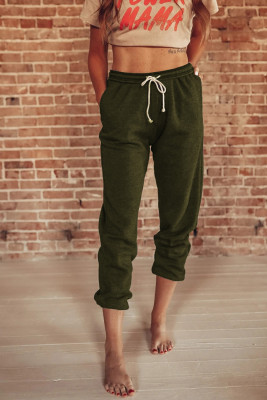 Зеленые спортивные штаны с карманами на кулиске